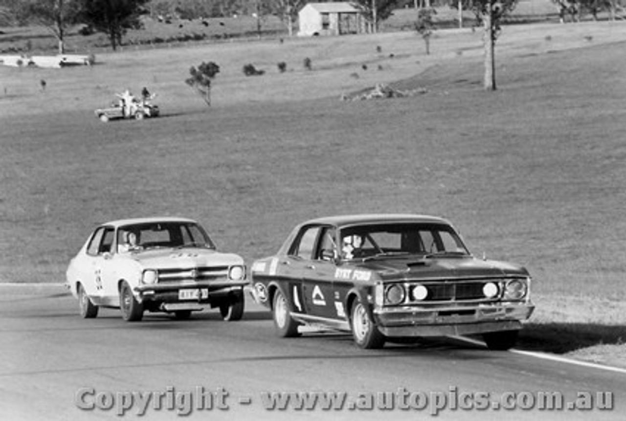 71024 - Phil Barnes Ford Falcon GTHO Leads Don Smith Torana XU1 Oran Park 1971