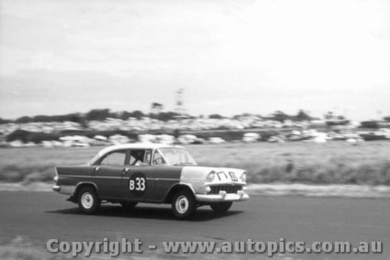 61713 - I. Strachan / J. Lanyon / D. Catzin  Holden EK - Armstrong 500 Phillip Island 1961