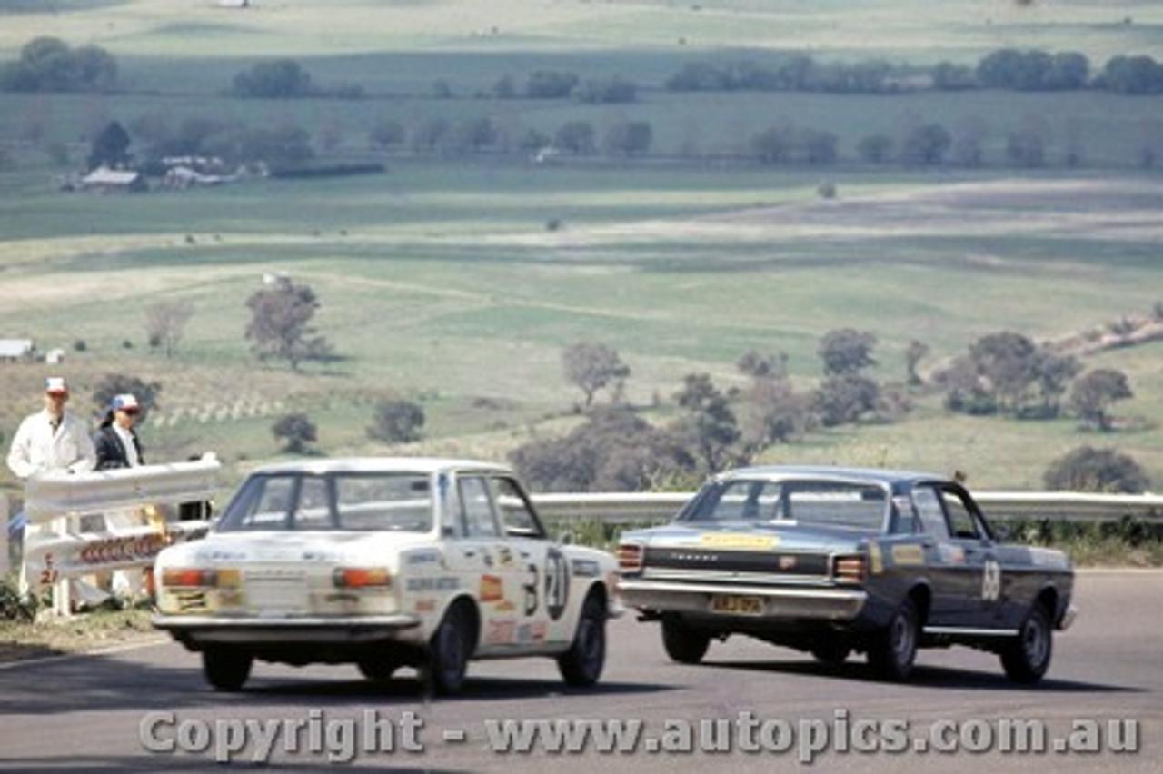 69759 - H. Tholstrup / B. Connell Datsun 1600 &  C. Smith / W. Ford  -  XW  Ford Falcon GTHO Auto - Bathurst 1969 -  Photographer  Lance J Ruting