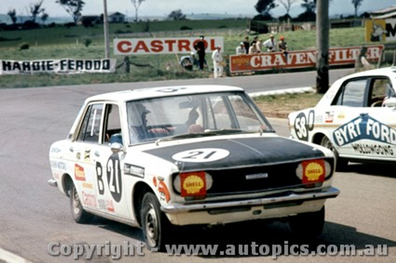 69765 - H. Tholstrup / B. Connell Datsun 1600 with a flat front tryre &  M. Chenery / E. Johnson  -  XW  Ford Falcon GTHO  - Bathurst 1969 -  Photographer  Lance J Ruting