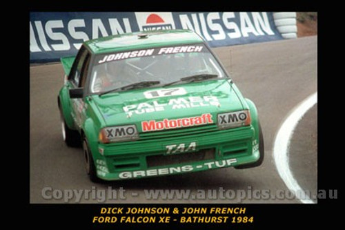 84717-1 Dick Johnson / J. French  -  Bathurst 1984 Ford Falcon XE - Printed with a black border and a caption describing the photo.