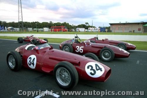 11503 - The three Maserati 250Fs and the AAR Eagle of Aaron Lewis at Phillip Island Classic - March 2011 - #4 Jeffery O Neill, #34 Peter Giddnigs and #36 Tom Price