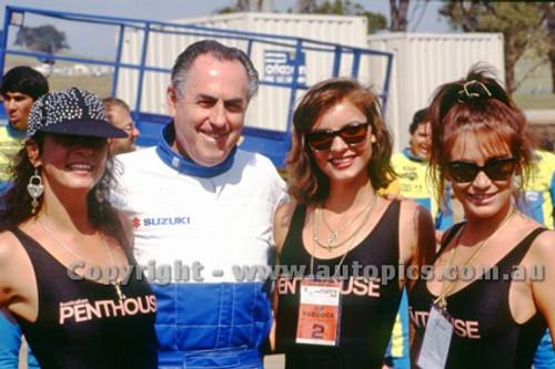 91320 - Sir Jack Brabham and the Penthouse Girls -  500cc Australian Gran Prix  Eastern Creek 1991 - Photographer Ray Simpson