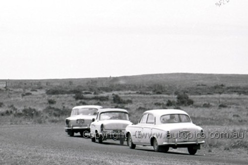 60760 - Bob Holden / K. Brigden Peugeot 403 & R. Christie / G. Hughes Simca Aronde &  Norm Beechey / John French  - Standard Vanguard    Armstrong 500 Phillip Island 1960 - Photographer Peter D'Abbs
