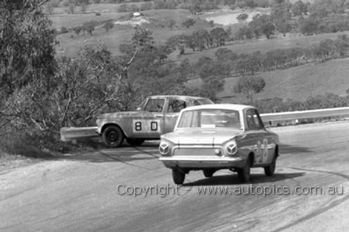 64759 - F. Sutherland / A. Mottram - Studebaker Lark & B. McPhee / B. Mulholland - Ford Cortina GT  -  Bathurst 1964 - Photographer Lance Ruting
