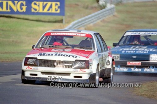 81068 - Peter Brock Commodore VC & Dick Johnson Falcon XD - Sandown 1981 - Photographer Peter D'Abbs