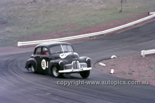 63028 - John Rootes, Holden FX - Oran Park 1963 - Anne Blackwood Collection