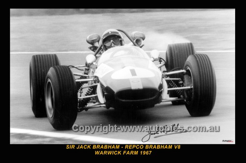 67505-2  -  Jack Brabham  -  Repco Brabham V8  Warwick Farm  1967 - Printed with a black border and a caption discribing the photo. Copy of an original photo signed by Sir Jack.