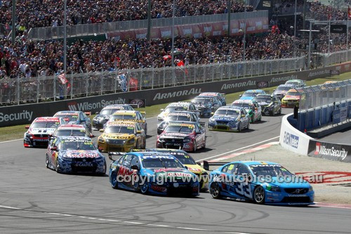 14052 -  The Start of the 2014 Supercheap Auto Bathurst 1000. Scott McLaughlin, Volvo S60 leds the pack - Photographer Craig Clifford
