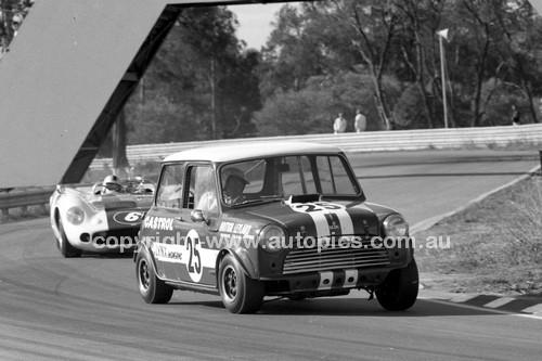 69328 - Don Holland, Mini S & Dennis Geary, Lola T70 MK2 - Warwick Farm 1969 - Photographer Lance J Ruting.