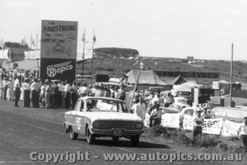 60702 - Bob Jane / L. Molina / Ford Falcon XK - Minus a windscreen after a roll - Armstrong 500 Phillip Island 1960