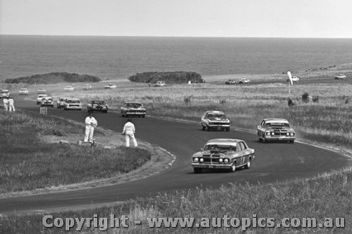 72042 - First Lap Phillip Island 1972 - Moffat and Gibson s Ford Falcon GTHO Phase 3 Lead the Field.