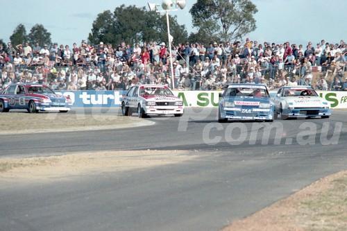 83405 - DickJohnson, Falcon / Allan Moffat, Mazda / Peter Brock Commodore / Allan Grice, Commodore -  Australian Touring Car Championship -  Wanneroo 24th April 1983 - Photographer Tony Burton