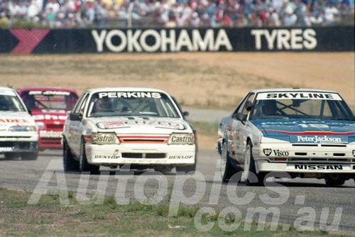 87112 - Glenn Seton Nissan Skyline & Larry Perkins Commodore - Wanneroo April 1987 - Photographer Tony Burton