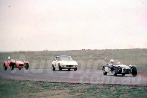 65331 - Bob Beasley, Lotus Super 7 & Fred Gibson, Lotus Elan - Oran Park 1965 - Photographer Lance J Ruting
