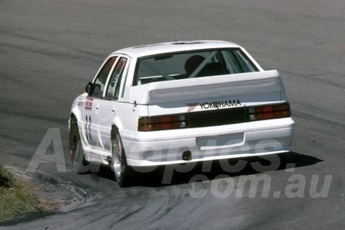 88829 - GARRY ROGERS / JOHN ANDRETTl , Commodore VL - Bathurst 1000, 1988 - Photographer Lance J Ruting