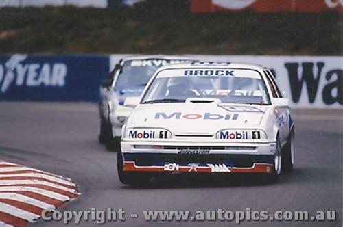 87015  -   Peter Brock Commodore VL - Amaroo 1987