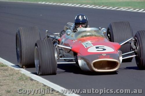68572 -  Graham Hill - Lotus 49 with a flat front tyre- Warwick Farm Tasman Series 1968 - Photographer Richard Austin