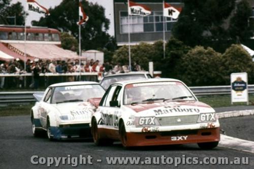 83014  -  Peter Brock - Holden Commodore VH / Allan Moffat - Mazda RX7 - Castrol 400 Sandown 1983