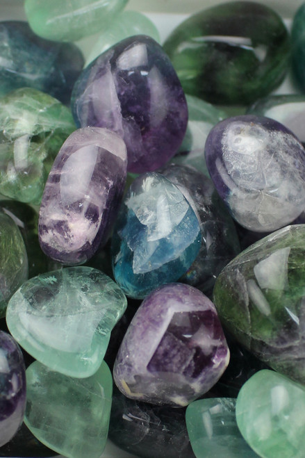 Fluorite   Metal enhancement and clarity, improved decision making, clearing the energy fields. stability to chaotic energy, absorbs negativity, cleanses the aura, strengthens bones and teeth