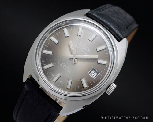 Swiss made automatic vintage watch Titan, new old stock NOS, brown dial, ETA 2783 movement, all stainless steel, leather strap