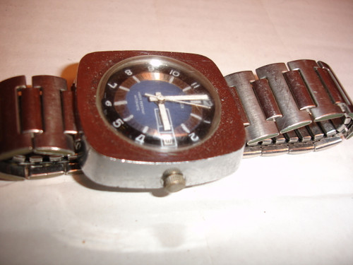HEAVY AND LARGE SQUARE CASE WITH ROUND DIAL COVERED BY ACRYLIC CRYSTAL + US MADE SPEIDEL STRETCH BAND