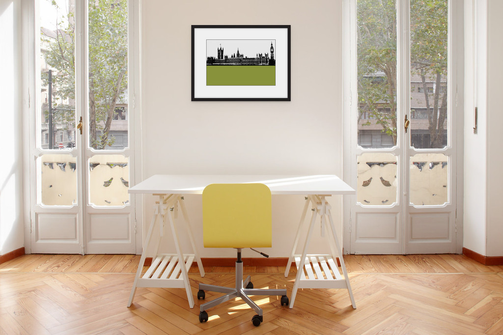Art print of the Palace of Westminster, also known as the Houses of Parliament in London by designer Jacky Al-Samarraie, mounted and framed on a wall in an office room.  The print colour is green.