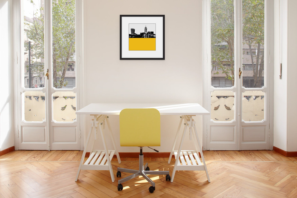 Art print of the OXO Tower and Walkie Talkie building in London by designer Jacky Al-Samarraie, mounted and framed on a wall in an office room.  The print colour is yellow.