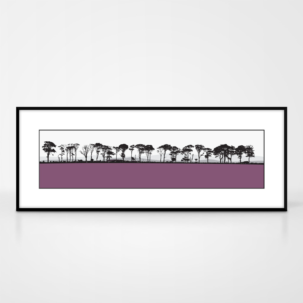 Landscape print of Northumberland countryside by designer Jacky Al-Samarraie.  The print colour is pink.  The print comes mounted but is shown in a frame for reference.