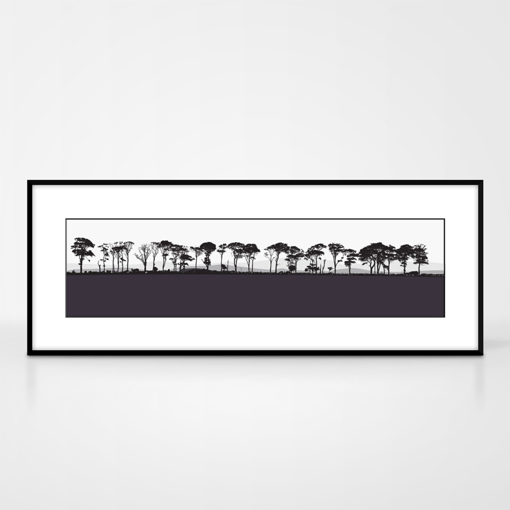 Landscape print of Northumberland countryside by designer Jacky Al-Samarraie.  The print colour is aubergine.  The print comes mounted but is shown in a frame for reference.
