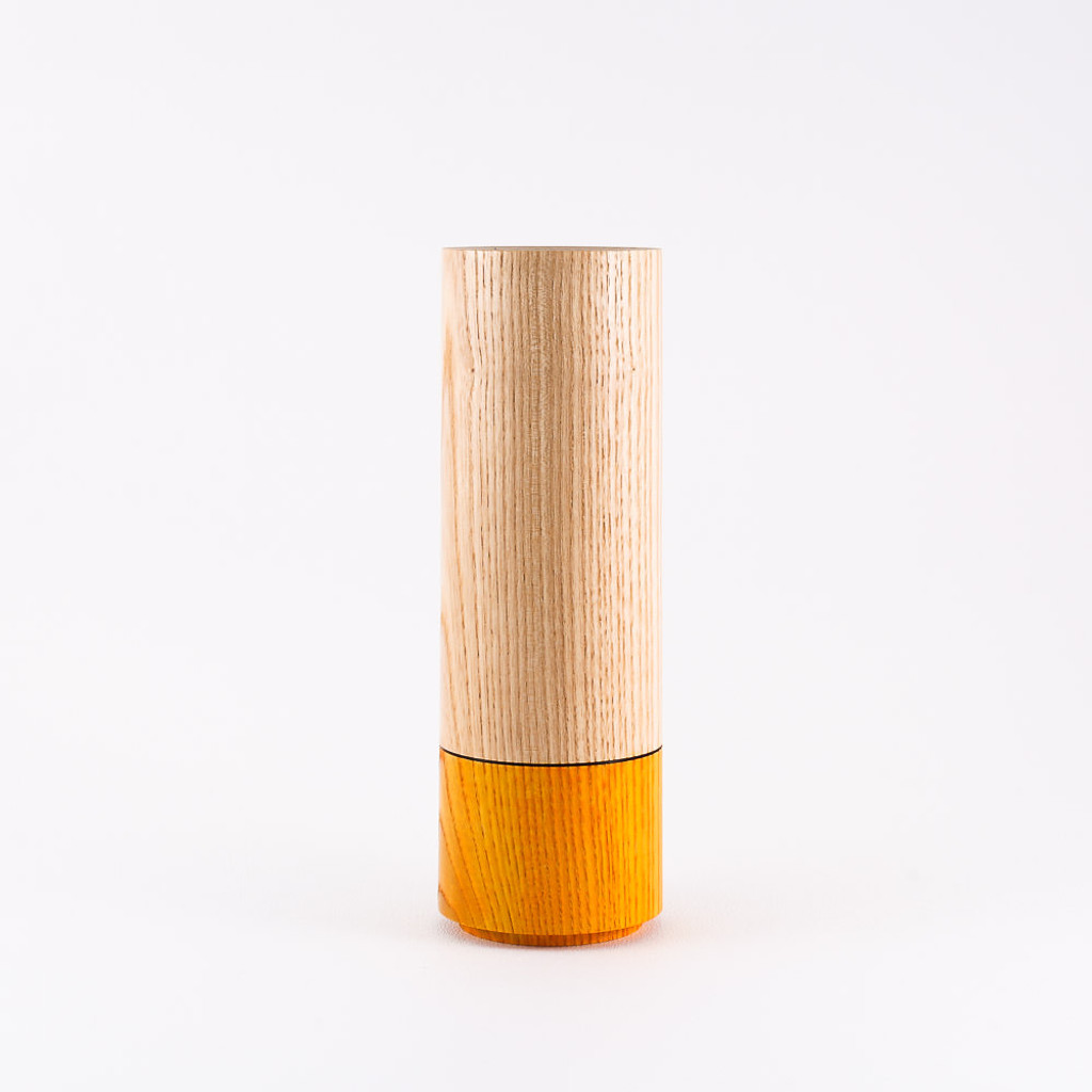 Orange wood stem vase by designer Jacky Al-Samarraie