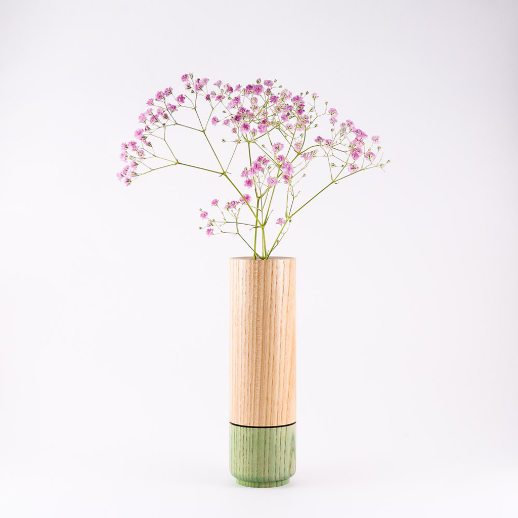 Peppermint wood stem vase by designer Jacky Al-Samarraie, with flowers in glass tube