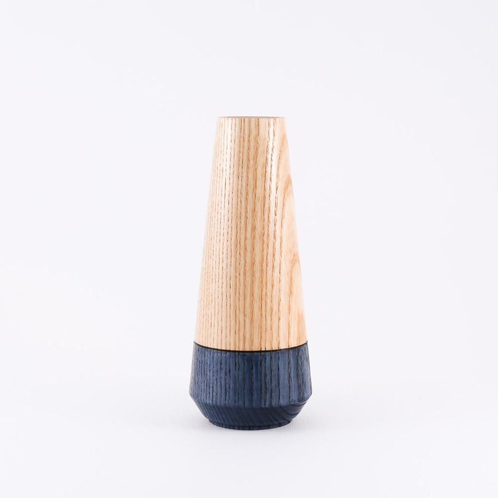 Blue wood stem vase by designer Jacky Al-Samarraie