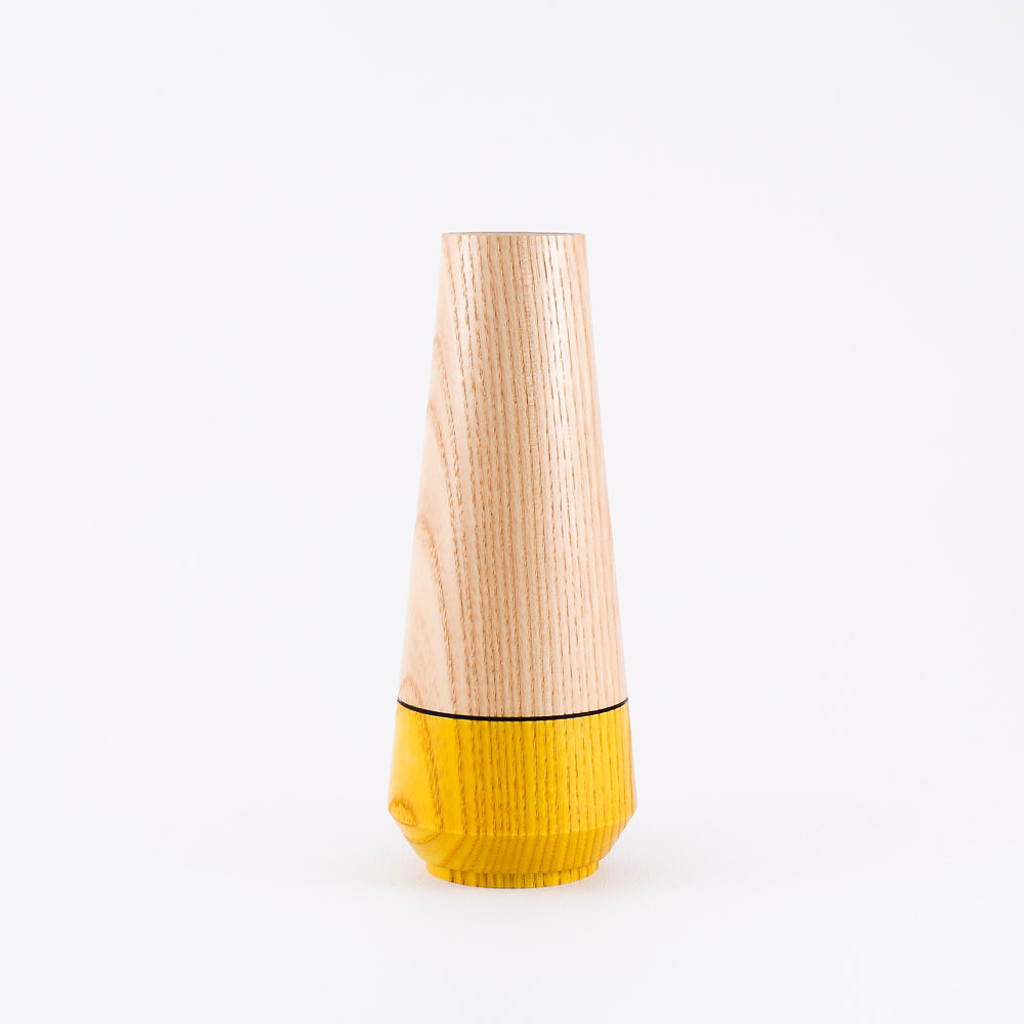 Yellow wood stem vase by designer Jacky Al-Samarraie