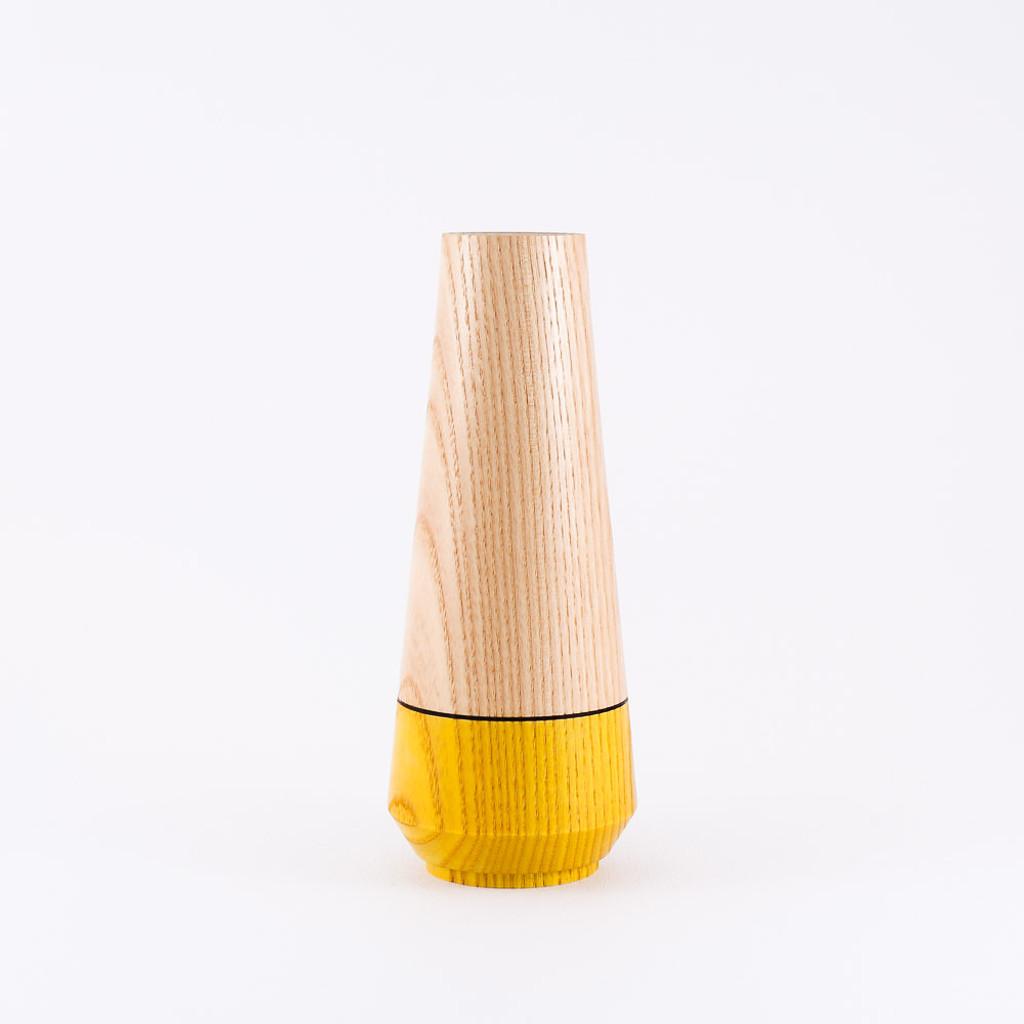 Yellow wood stem vase by designer Jacky Al-Samarraie
