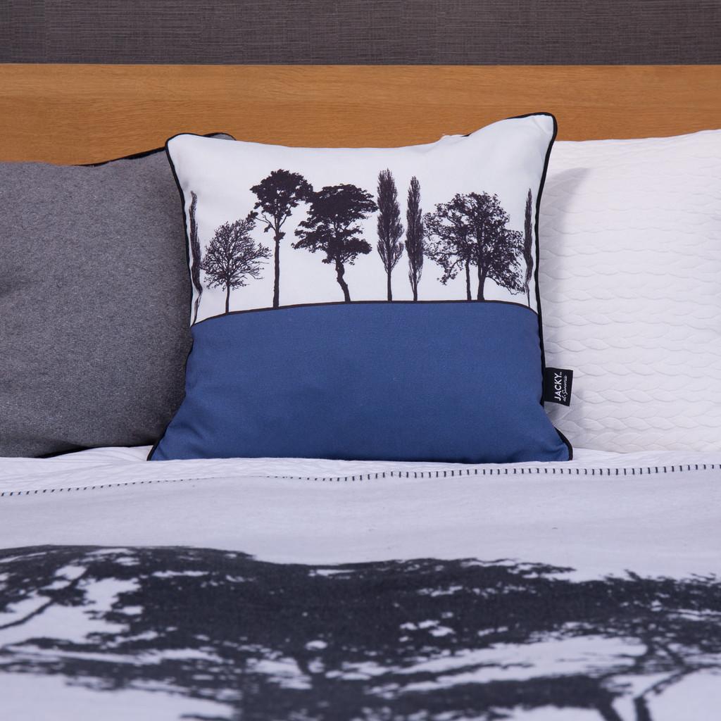 Blue Engligh countryside landscape cushion shown on bed, by designer Jacky Al-Samarraie