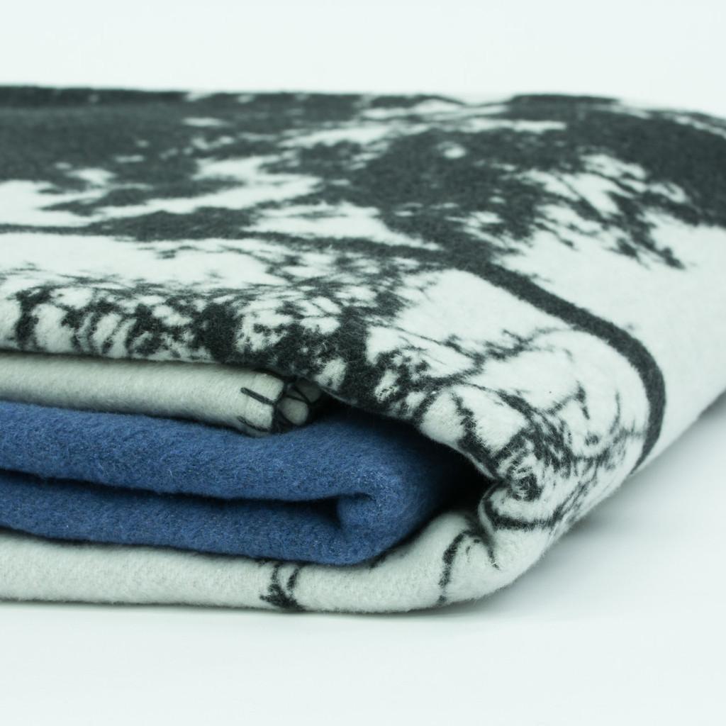 Blanket stitch detail of blue woven cotton throw by designer Jacky Al-Samarraie