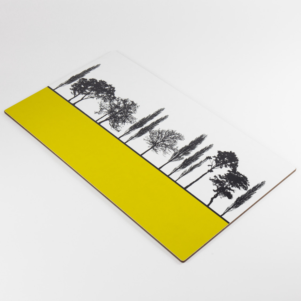 Detail of mustard British landscape melamine chopping block by designer Jacky Al-Samarraie