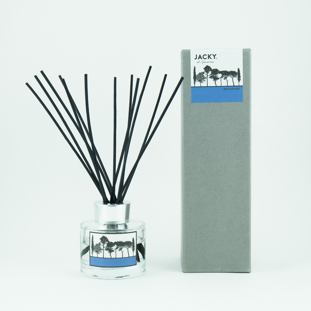 Pomegranate and black pepper fragranced reed diffuser in box by designer Jacky Al-Samarraie