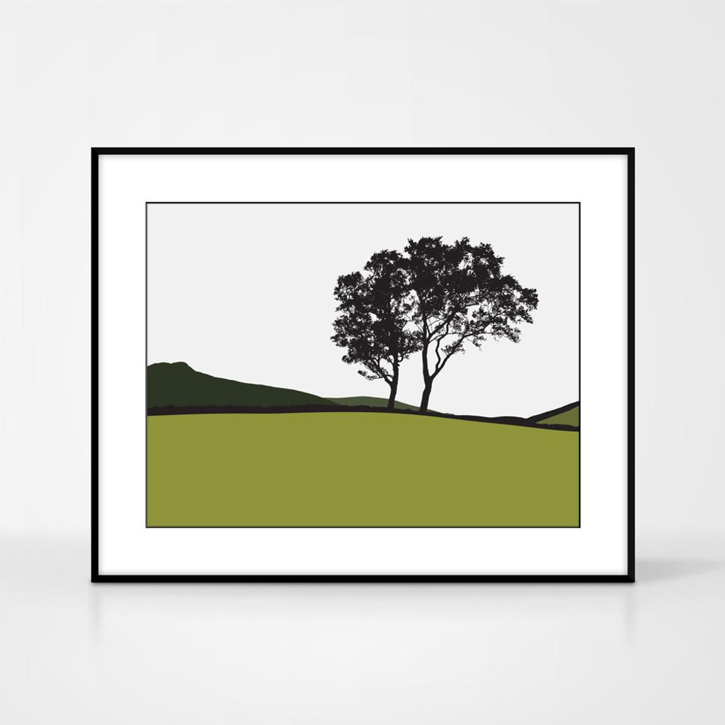 Landscape print of trees in Braemar, Scotland by designer Jacky Al-Samarraie.  Shown in frame for reference.