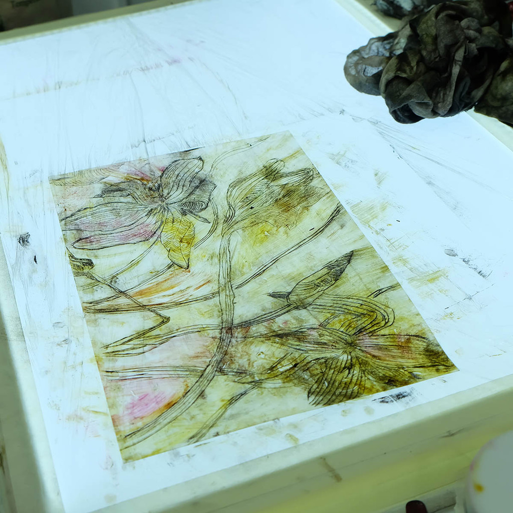 Floral drypoint plate on light box