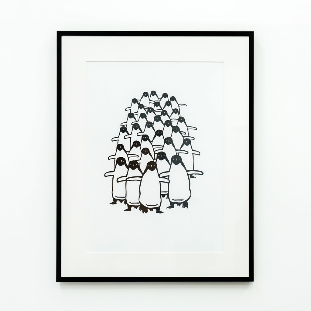 Framed Penguin print on wall - by Jacky Al-Samarraie