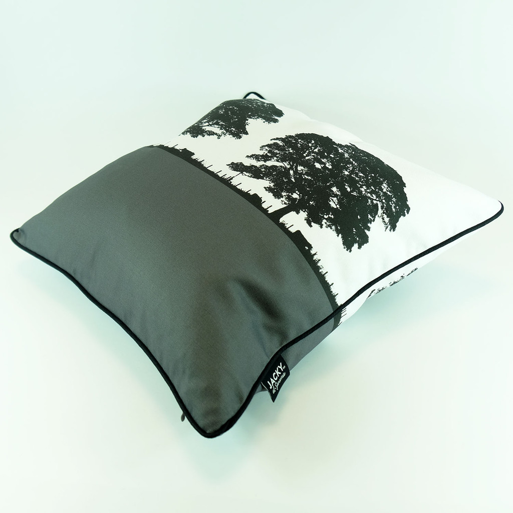 Grey cotton cushion with landscape tree design by Jacky Al-Samarraie