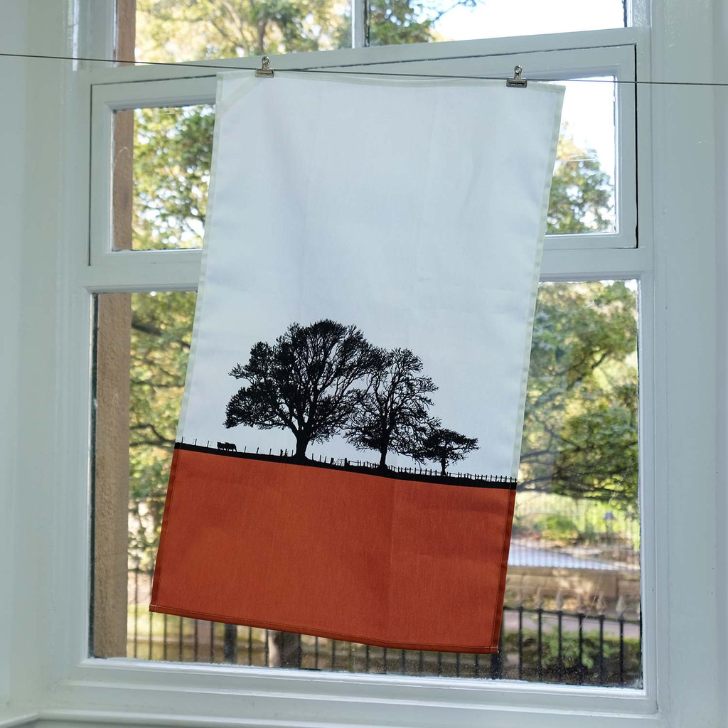 Landscape cotton tea towel by Jacky Al-Samarraie in Orange colour