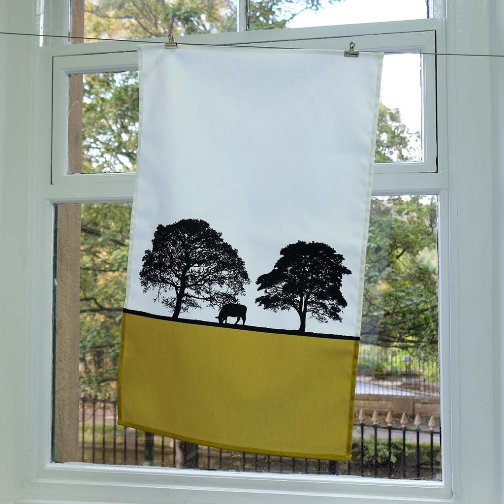Landscape cotton tea towel with trees by Jacky Al-Samarraie. Mustard Colour.