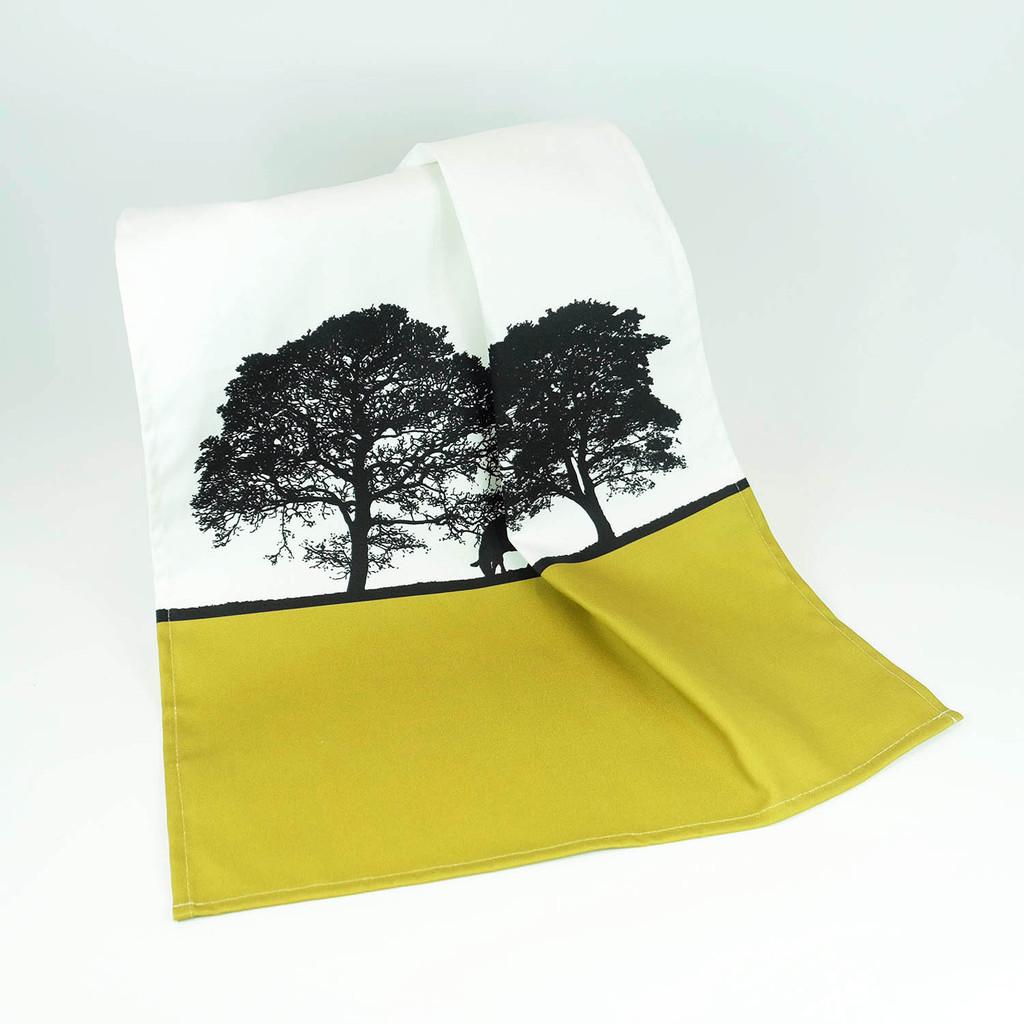 Mustard cotton tea towels with tree landscape design by Jacky Al-Samarraie