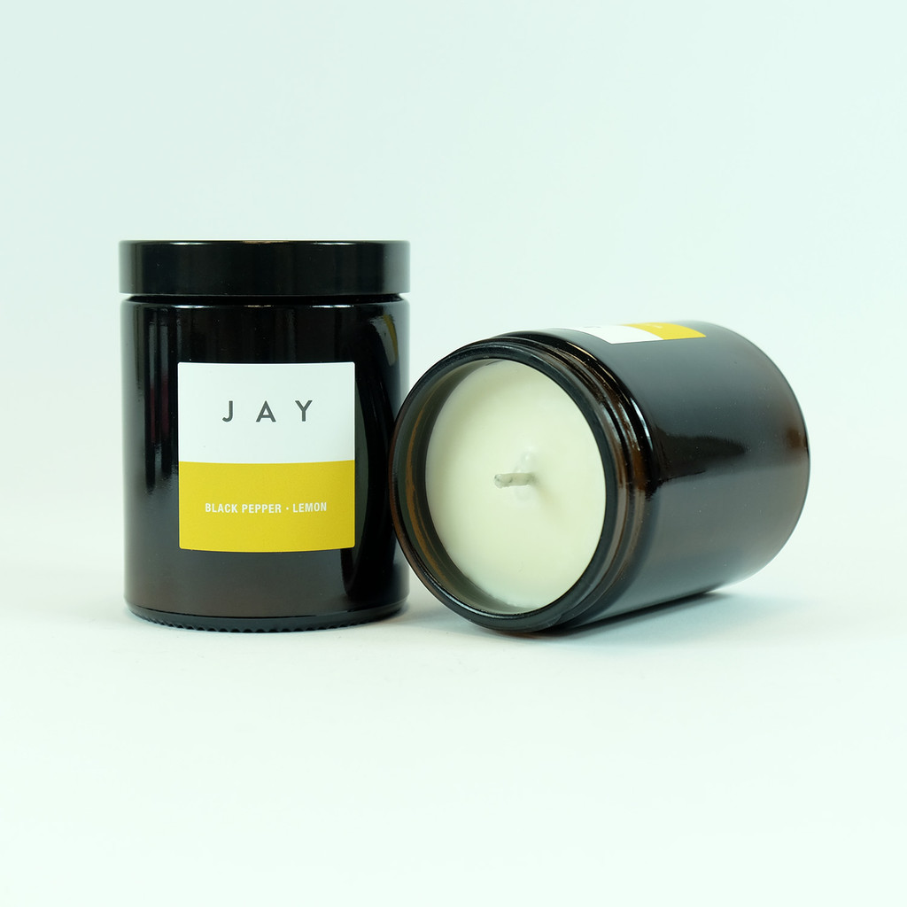 Black pepper & lemon candle jar by Jacky Al-Samarraie
