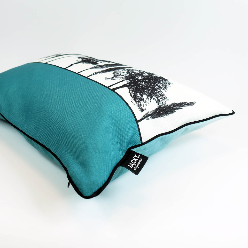 Side view of teal English countryside cushion by designer Jacky Al-Samarraie