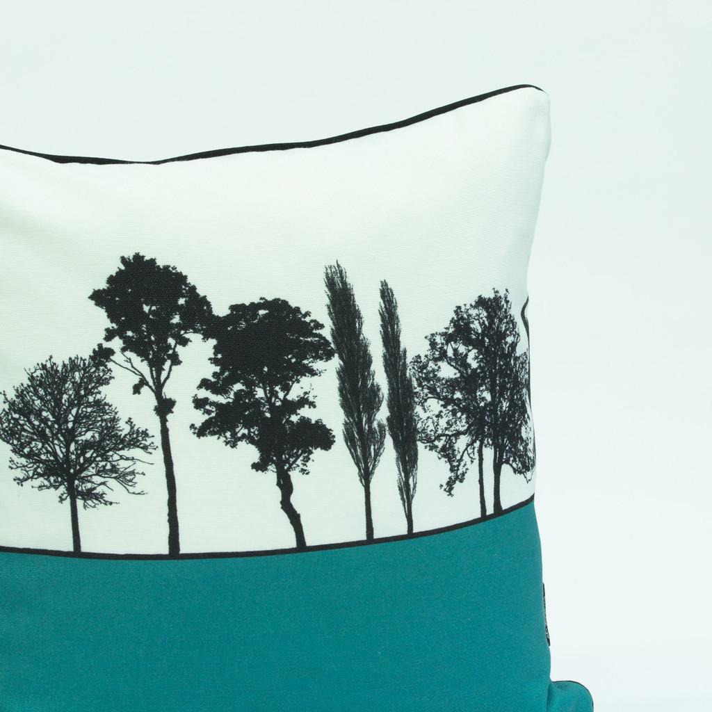 Close-up detail of teal landscape silhouette cushion by designer Jacky Al-Samarraie