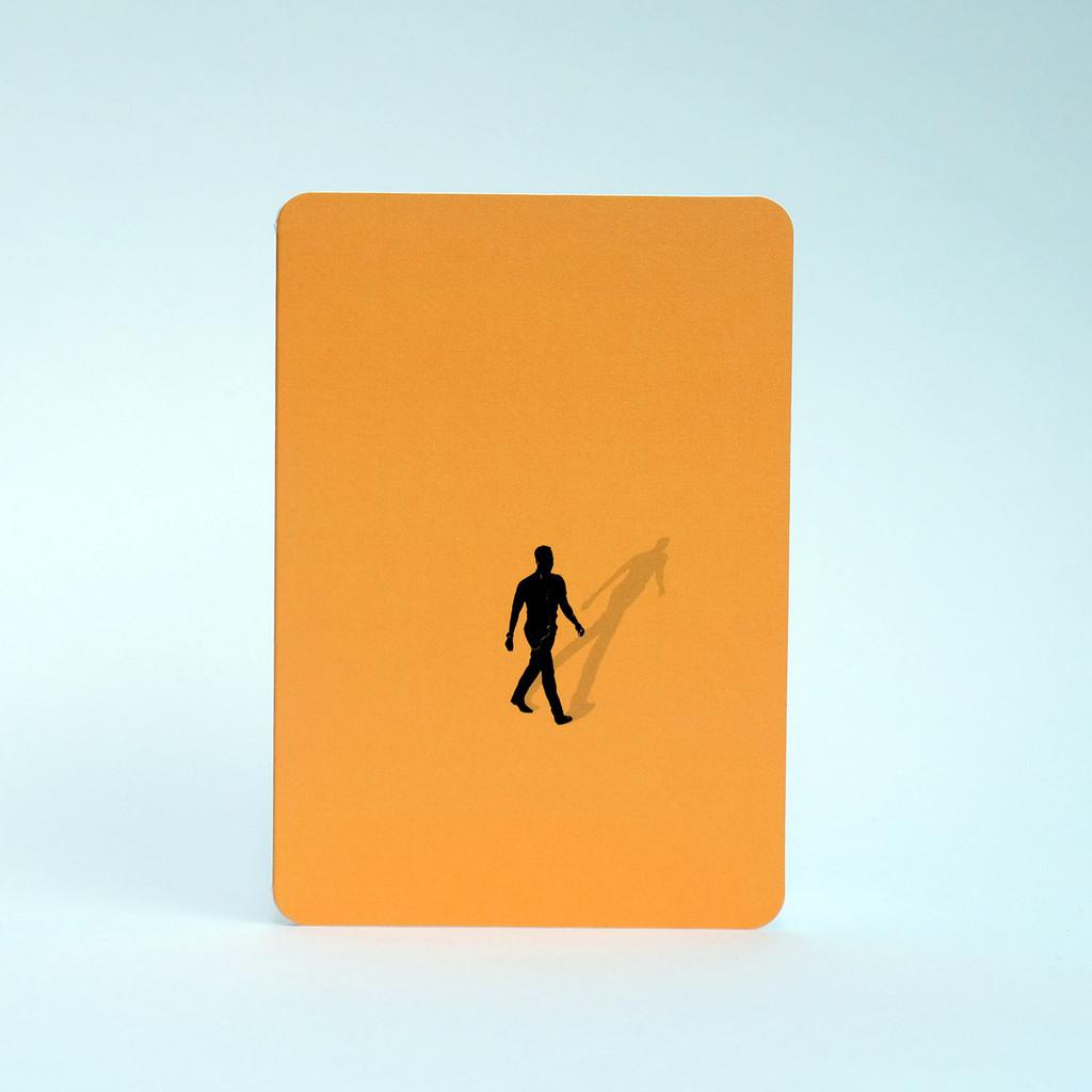 Man silhouette greeting card in orange by Jacky Al-Samarraie